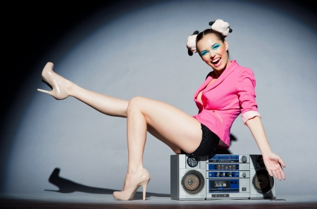 Merry disco girl with a tape recorder Stock Photo