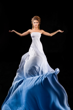 Enchantress in long white dress Stock Photo - 16567359