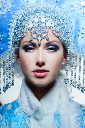 Snow maiden with blue eyes Stock Photo