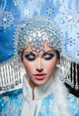 ice queen: Snow maiden with blue eyes Stock Photo