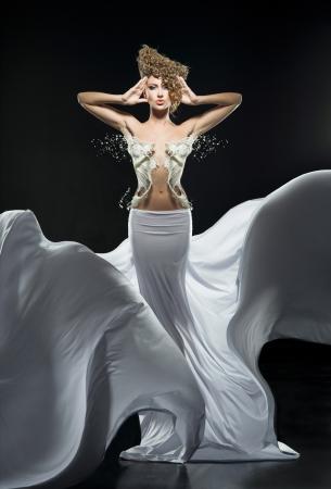 Pretty girl in fantastic white dress