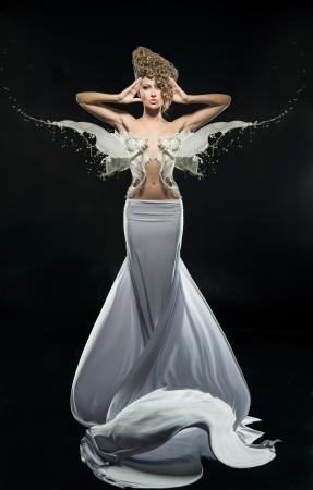 Pretty girl in fantastic white dress Stock Photo - 17049488