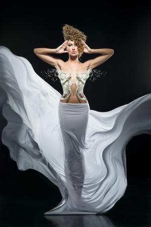 Pretty girl in fantastic white dress Stock Photo - 17049490