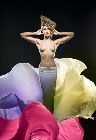 Pretty girl in fantastic colorful dress Stock Photo - 17008446