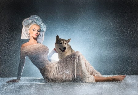 ice queen: Beautiful snow maiden with dog Stock Photo