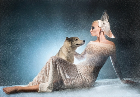 Beautiful snow maiden with dog Stock Photo - 17130053