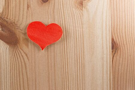felicitation: Wooden background with paper heart