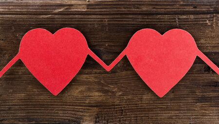 felicitation: Wooden background with paper hearts