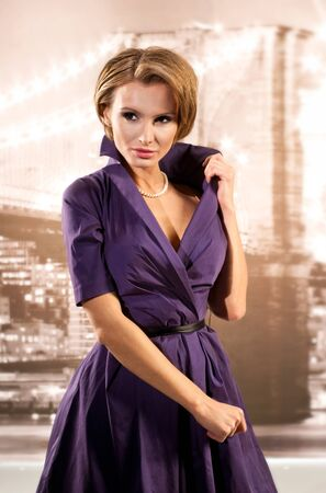 Attractive girl in a lilac dress Stock Photo - 17383548