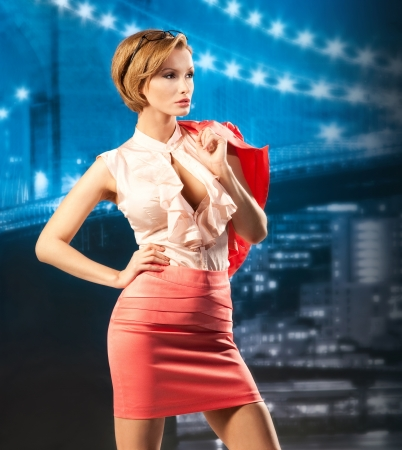city coat of arms: Stylish business woman in night city