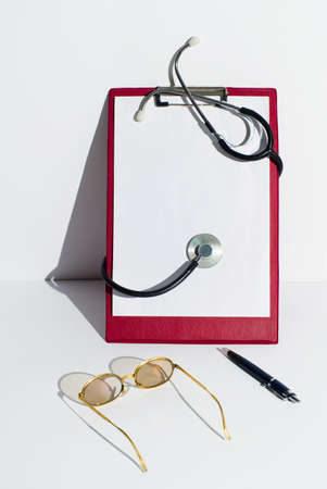 Notepads with paper and stethoscope photo