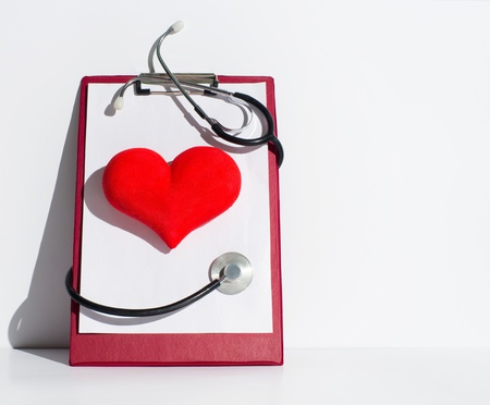 Heart and stethoscope on the notepad Stock Photo - 17457568