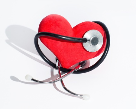 Heart and stethoscope on the white background Stock Photo - 17505515