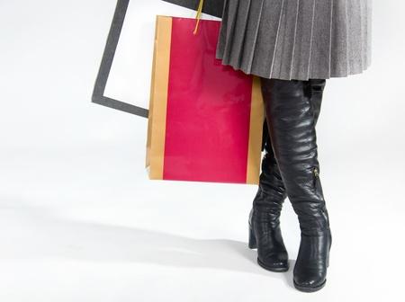Bottes Noires, Jupe Plissée Et Un Sac Banque D'Images Et