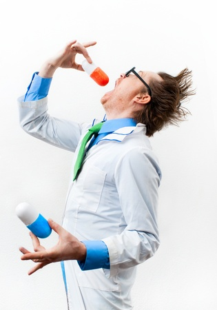 bolus: Funny doctor in glasses swallow bolus Stock Photo