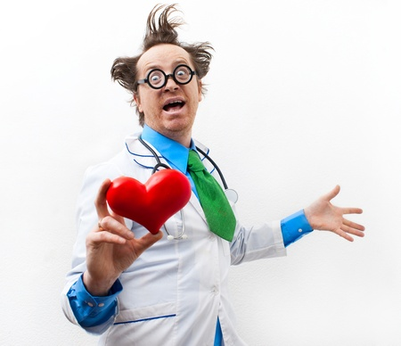 Funny doctor cardiologist with heart in hand