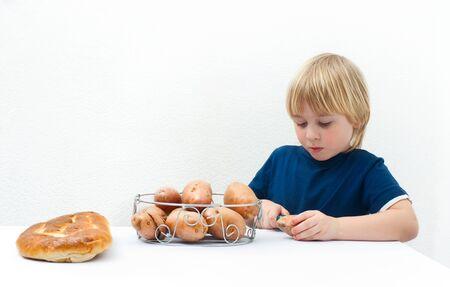 industrious: Industrious little boy peeling potatoes