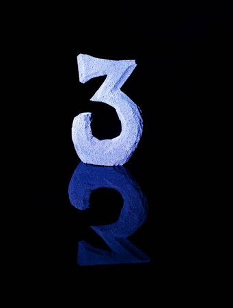 Numeral three on black background Stock Photo - 18385571