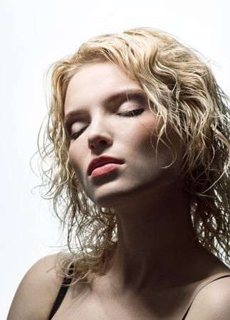 Portrait of beautiful blonde with eyes closed photo