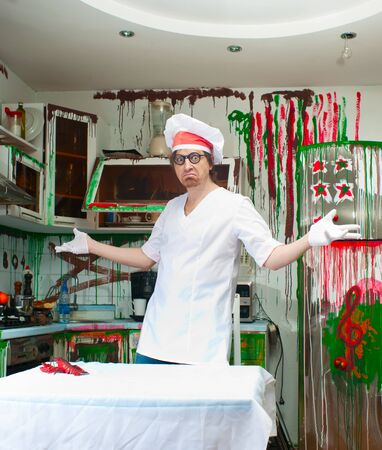 Crazy cook in the painted kitchen Stock Photo - 18659720
