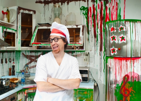 Cheerful cook in the painted kitchen Stock Photo - 18659736