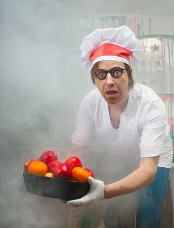 Funny chef with fruit in smoke photo
