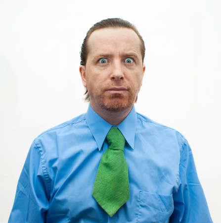 occhi sbarrati: Uomo d'affari pazzesco con gli occhi ben aperti Archivio Fotografico