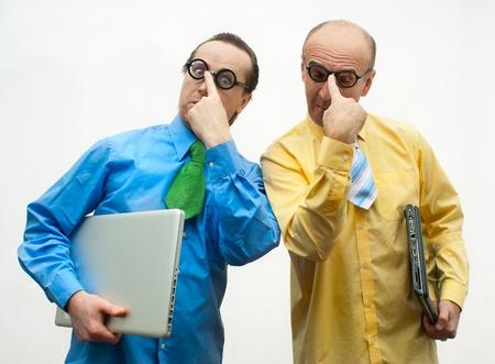 brainy: Two brainy businessman with laptops