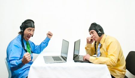 Two thoughtful programmer opposite each other photo