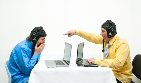 Two frightened programmer opposite each other photo