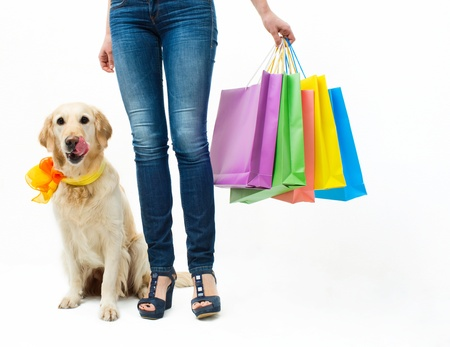 Girl in jeans with the dog and packages photo