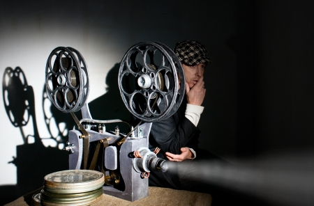 Projectionist and film projector with film photo