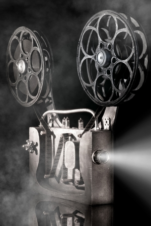 old movies: Movie projector with the film
