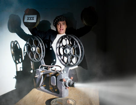Funny projectionist shows new film photo