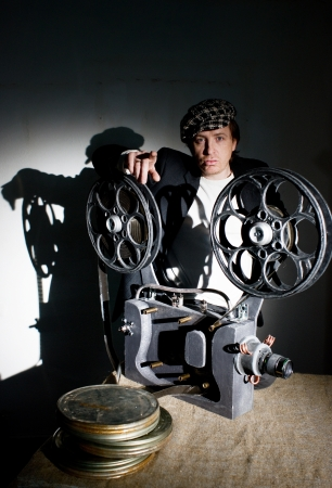Projectionist is preparing to show the film photo
