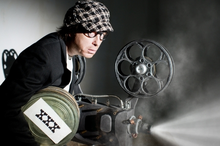 Crazy projectionist shows new film photo