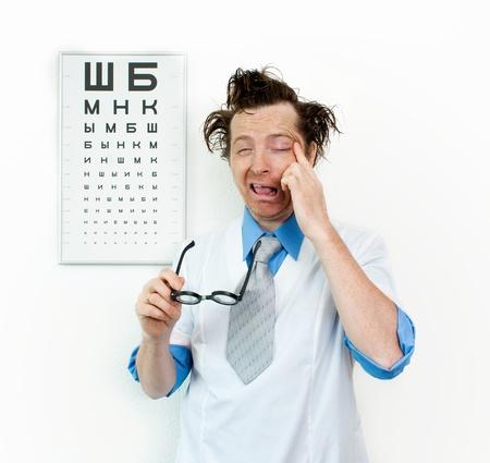 oculist: Funny oculist with eyes closed