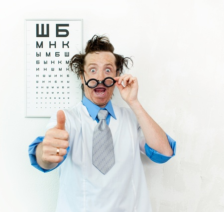oculist: Crazy oculist with disheveled hair  Stock Photo
