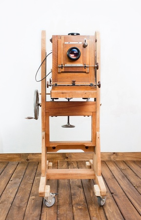 Retro photo camera is on the wooden floor