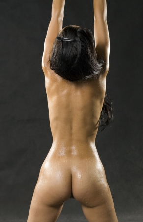 naked girl black hair: Beautiful figure of a girl from the back Stock Photo