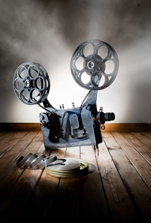 Movie projector with the film on the wooden floor Reklamní fotografie