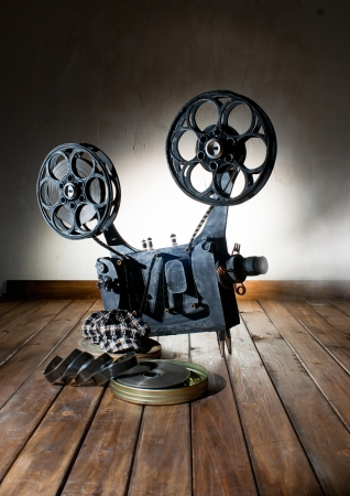 metier: Movie projector with the film on the wooden floor
