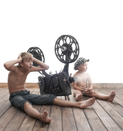 Two boys can see a interesting movie photo