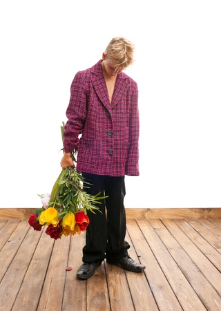 Sad teenager with a bouquet of flowers Stock Photo - 21398957