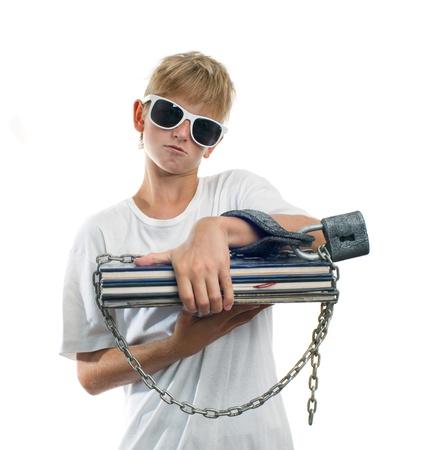 slacker: Lazy schoolboy in handcuffs with lock