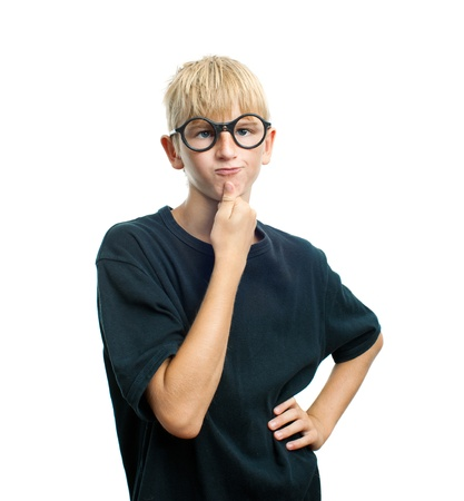 puzzling: Pensive teenager with round glasses