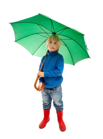 Little boy with green umbrella photo