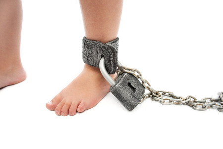 disobedient: Foot a little boy in chains