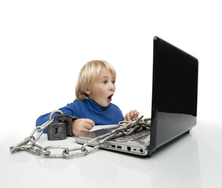 Little boy in handcuffs is studying computer Stock Photo - 22399608