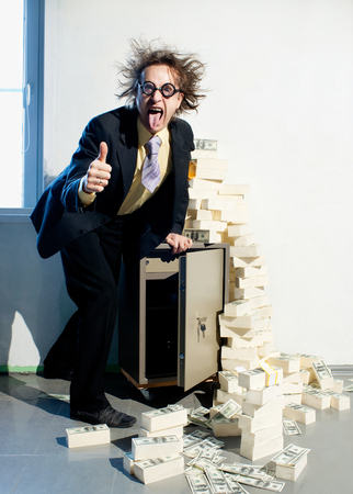 Crazy banker with bunch of money photo